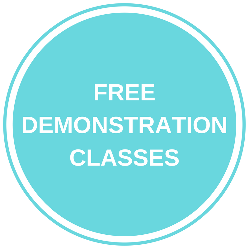 "Teal circle with ""Free Demonstration Classes"" text inside"